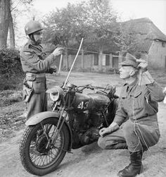 Photo - Corps of Military Police motorcyclists demonstrate how a metal rod fitted to a motorcycle can prevent the rider from being killed by a wire stretched across the road, 25 October (Image courtesy Imperial War Museum) British Motorcycles, Cool Motorcycles, Vintage Motorcycles, Photos Corps, Police Officer Requirements, Germany Ww2, Ww2 Photos, Military Police, Usmc