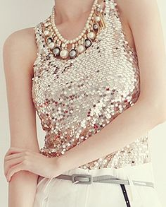 A pink sequined tank and a statement necklace add glam to your holiday style.   Mary Kay