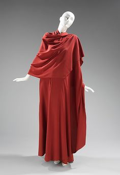 Madame Gres uses silk crepe to create soft drapery; the center front panel falls in an eye-catching cascade of folds; or if desired, the panel can be wrapped around the body in the style of a h Ancient Greek Dress, Ancient Greek Clothing, Madame Gres, Greek Fashion, Greek Inspired Fashion, Designer Evening Dresses, Evening Gowns, Costume Collection, Drawing Clothes