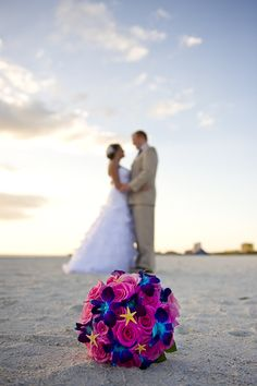 Flowers - orchids & replace pink with purple & turquoise. Like the starfish in the bouquet.