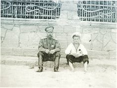 Nicholas and Alexei in Evpatoria on 16 May, 1916. Father and son are sitting just outside the fence of the infirmary of Empress Alexandra Feodorovna. This may be the last photo taken of the Romanov family members in Crimea. Theromanovfamily.com