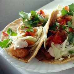 Fish Tacos - I'm from San Diego and these taste just like home! Chunks of cod are fried in a beer batter, and served in corn tortillas with shredded cabbage and a zesty white sauce. Serve with homemade pico de gallo, and lime wedges to squeeze on top! Fish Recipes, Seafood Recipes, Mexican Food Recipes, Great Recipes, Cooking Recipes, Favorite Recipes, Healthy Recipes, Cooking Fish, Cod Recipes