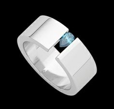 18ct white gold with tension set pear shaped treated blue diamond.  The 4th, 5th, 18th and 65th anniversaries are associated with the color blue, though the 65th is sky blue, I imagine this would do.  Gorgeous ring...