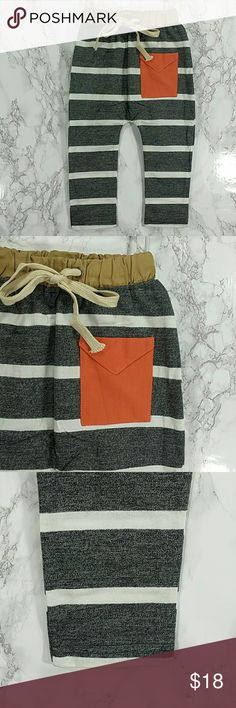 Dark gray Orange Pocket jogger pants. Kids Adorable and comfortable dark gray and white stripes jogger pants with an orange pocket.  Pull up style.  This item is brand new and never used.  #23732 Bottoms Sweatpants & Joggers