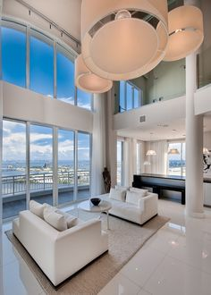 Stunning Miami penthouse by Baltus. With a view like this you don't need much in the way of furnishings. An impressive space by any standards....V