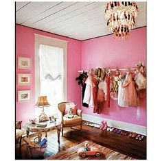 love the dress up clothes hanging on the wall..so little girlish
