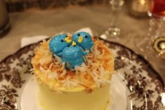 Precious blue birds on a coconut nest are the perfect addition topping for a springtime dessert