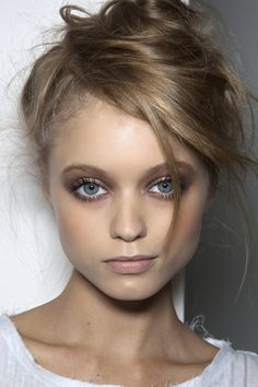 For an understated look, try a tousled updo and natural make-up.