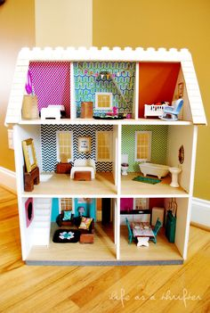 Life as a Thrifter: The Dollhouse - Dollhouse from Hobby Lobby. I want to do one for Clara when she's big enough. Love the wallpaper and refinished thrift store furniture.
