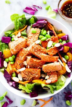 Asian Pan Seared Salmon Salad is bright and vibrant and complete with an amazing honey sesame dressing that takes this salad to ...