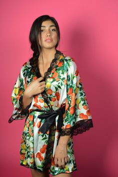 This fruity, sultry loungewear hints of a juicy little secret you're hiding underneath. With mirrored lemons and oranges climbing green leaves up a white background, this Dolce & Gabbana inspired print is sweet and striking. Added to the drama is wide black lace along the neckline and 2/3 length sleeves. When closed off by the black silk dupioni belt, the scalloped lace gives a little peek-a-boo look along the decollete.     Perfect for summer, but great year-round, you'll love this…