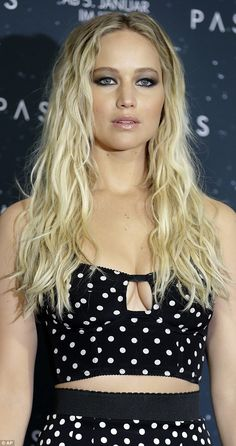Jennifer Lawrence attended a photocall for Passengers at Hotel Adlon in Berlin on Friday (III) She wore her long golden tresses in waves from a middle parting and decorated her eyes with thick eyeliner and smokey shadow