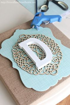 diy layered burlap monogram, crafts, decoupage, Hot glue your layers onto the burlap canvas
