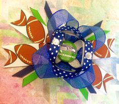 A personal favorite from my Etsy shop https://www.etsy.com/listing/246053727/dazzle-seahawks-bow