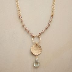 """TICK TOCK NECKLACE--A pendulum culminating in pale green amethyst ticks the day away on a strand of cubic zirconia and 14kt gold filled links. Hook clasp. Handmade for us in USA. Approx. 36""""L."""