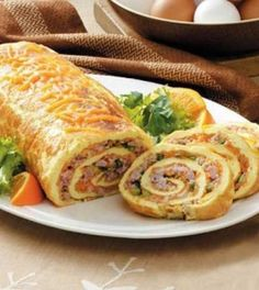 Recipe for Ham n Cheese Omelet Roll - This brunch dish has wonderful ingredients and an impressive look all rolled into one! I love hosting brunch…and this special omelet roll is one of my very favorite items to prepare and share.