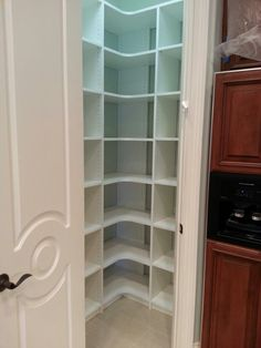 Pantry With Corner Shelves By Naples Closets LLC