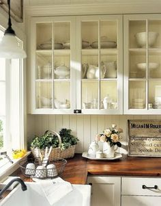 White cabinets with butcher block counters