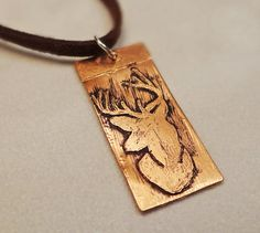 Etched copper pendant Etched copper buck by BulletsBeadsBaubles