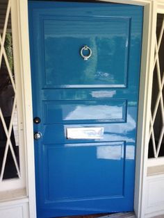 high gloss lacquer front door. teal green front door with black