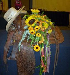 floral arrangements designed in a western saddle   ... Zen garden design, and a saddle with flowers became a casket spray