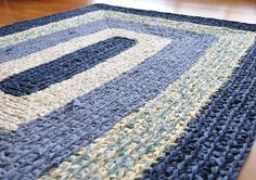 rug crocheted from strips of fabric found in thrift stres - I can make this for my kitchen! Reminds me of the braided rugs my grandmom used to make. :)