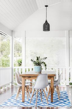 Refreshed Queenslander An old kitchen table has been shifted outdoors and teamed with replica Eames chairs. A blue and white outdoor, geometric rug freshen up the space. Outdoor Rooms, Outdoor Dining, Outdoor Chairs, Adirondack Chairs, Outdoor Ideas, Outdoor Pergola, Outdoor Lounge, Patio Ideas, Long Chair