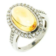 Get the best price for  LenYa Special - Stunning new design Valentines Day Sterling Silver Ring with Oval Citrine, Round Cubic Zirconia, (Ring Size 7.25)