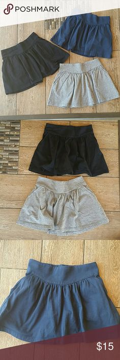 💥BUNDLE💥 SKATER SKIRTS 🎀Navy, black and gray  🎀Elastic back waist 🎀Front pockets 🎀100% cotton 🎀No rips, stains, pilling or fading 🎀No hidden shorts underneath 🎀Size is small 5-6 🎀Smoke free home Crazy 8 Bottoms Skirts