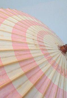 Pink striped sun umbrella