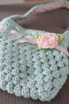 Love the colour and the embelishments. This one was crocheted using this pattern: http://speckless.wordpress.com/2010/11/19/free-crochet-pattern-bobble-licious-bag/