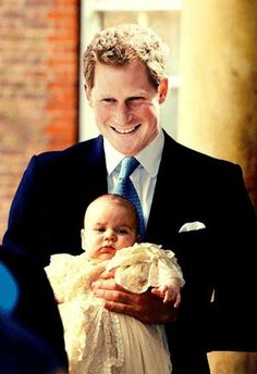Prince Harry with baby nephew Prince George, at George's Christening 2013