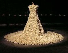 British artist's Susie MacMurray's bridal dress is made from 1,400 inverted rubber gloves - yes, just the common household variety for doing the dishes.