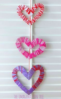 Yarn wrapped hearts mobile Valentine's day craft for kids