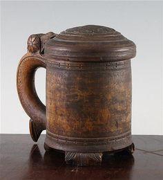 Lot 10: A 19th century Norwegian birch peg tankard, 7.25in., faults - Gorringes | AuctionZip