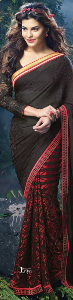 Jacqueline Fernandez in a black georgette saree and full sleeve blouse. Indian Bollywood Fashion.