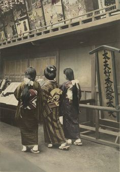 Three women walk to a matinee show at the theater. 1910's, Japan
