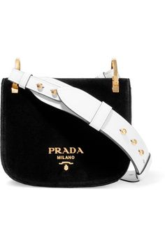 Black velvet, white leather (Calf) Snap-fastening front flap Comes with dust bag Weighs approximately 1.1lbs/ 0.5kg Made in Italy