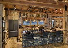 Rustic Kitchen Island Design with Stone and Ceramic Countertop and Also Rubber Seats Log Cabin Living, Log Cabin Homes, Log Cabin Kitchens, Modern Log Cabins, Rustic Kitchen Island, Wooden Kitchen, Country Kitchen, Cuisines Design, My Dream Home