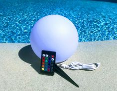 Rechargeable or solar floating pool lights will light up any party. Or if you prefer you can stake the lighted sphere into the ground. With the remote you can choose white or any color. Floating Pool Lights, Pool Candles, Pool At Night, Big Swimming Pools, Outdoor Party Lighting, Swimming Pool Accessories, Umbrella Lights, Pool Party Decorations, Pool Fountain