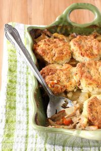 Chicken Pot Pie Casserole topped with homemade bacon cheddar biscuits