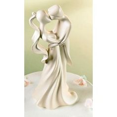 LOVE THIS!!! Sweetest First Kiss Wedding Cake Topper- this one is made of bonded marble.