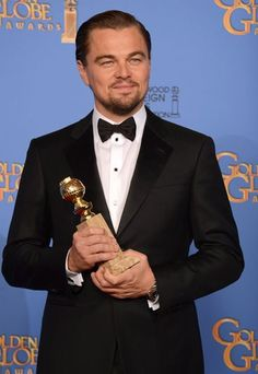 Leonardo DiCaprio winning his golden globe for best comedy in Wolf of Wall Street