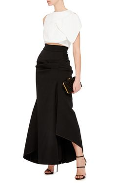 This **Maticevski** Succession skirt features pleated details on the front and back a high split