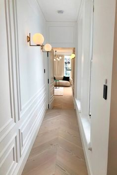 A traditional yet contemporary feel to this newly refurbished property. White panelled walls and light oak flooring complete the hallway lleading down to the guest bedroom. Hallway Wall Lights, Hallway Walls, White Wall Paneling, Modern Wall Paneling, Paneling Walls, Living Room Panelling, Wall Panelling, White Rooms, White Walls