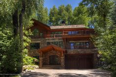 735 E Francis Street - Listing # 126406 - Price: $7,975,000 - Surrounded by beautiful tiered landscaping, this elegant home sits on a peaceful cul-de-sac in Oklahoma Flats. Fantastic views of Aspen Mountain from all of the living areas and the four bedrooms. Stone decks and patios surround the house providing views and privacy. Great room includes a see through gas fireplace, formal dining room and piano nook. Spacious and luxurious master bedroom suite with his and hers walk in closets.