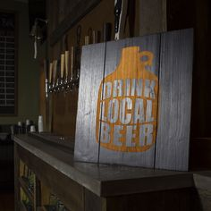 Drinking local is more than just a brew in hand, it's the pride and support of the brewery vision. The Drink Local Growler Wood Sign is crafted from Fir wood then etched with a custom growler design t