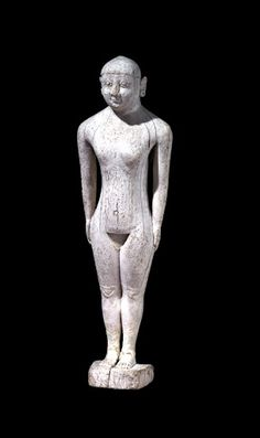 Hittite|1400-1200BC|This beautiful figurine of a Hittite girl is made of ivory. She stands in a  formal pose with her hands by her sides and the proportions of the figure,  lack...