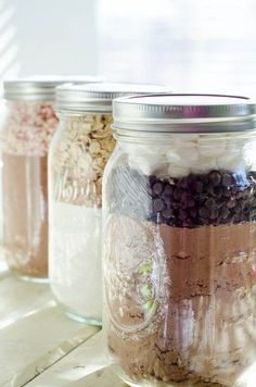 EASY cookie mason jar recipes: Hot Chocolate Cookies, Buttered Toffee Oatmeal Cookies, and Fudge Peppermint Crinkle Cookies.  YUM. One day when you're feeling extra ambitious, with lots of time on your hands - fill up these jars with the dry ingredients, so you'll always have them on hand when you're craving cookies but in a lazy mood! ;-)