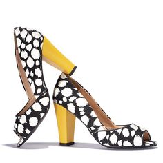 Blurry Dot Fashion Pump  Totally mod! Peep-toe pump in graphic black and white with a bright yellow heel for a pop of color. Dress up the simplest of outfits with these cute, stylish pumps. Break the mold with pumps that pop!